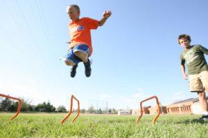 Kids jumping hurdles